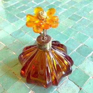 Vintage amber glass perfume atomizer , flower top
